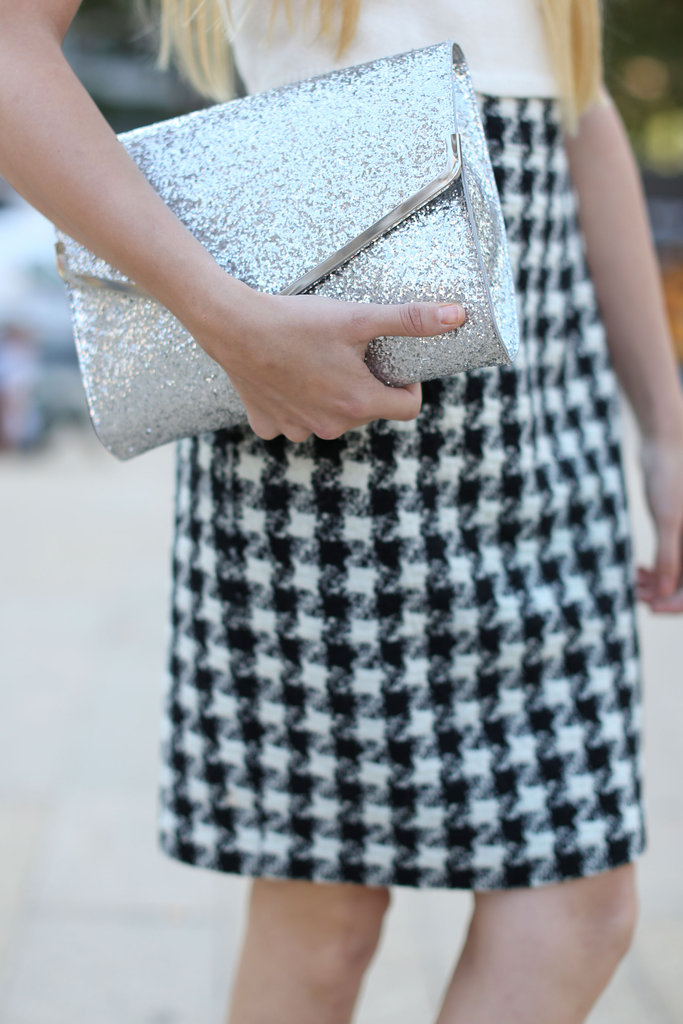 A glittery clutch popped against a classic houndstooth skirt.