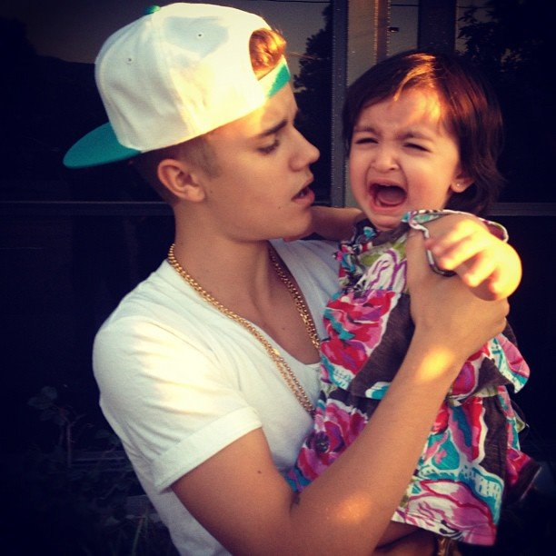 Justin Bieber held a less-than-adoring fan in his arms. Source: Instagram user justinbieber