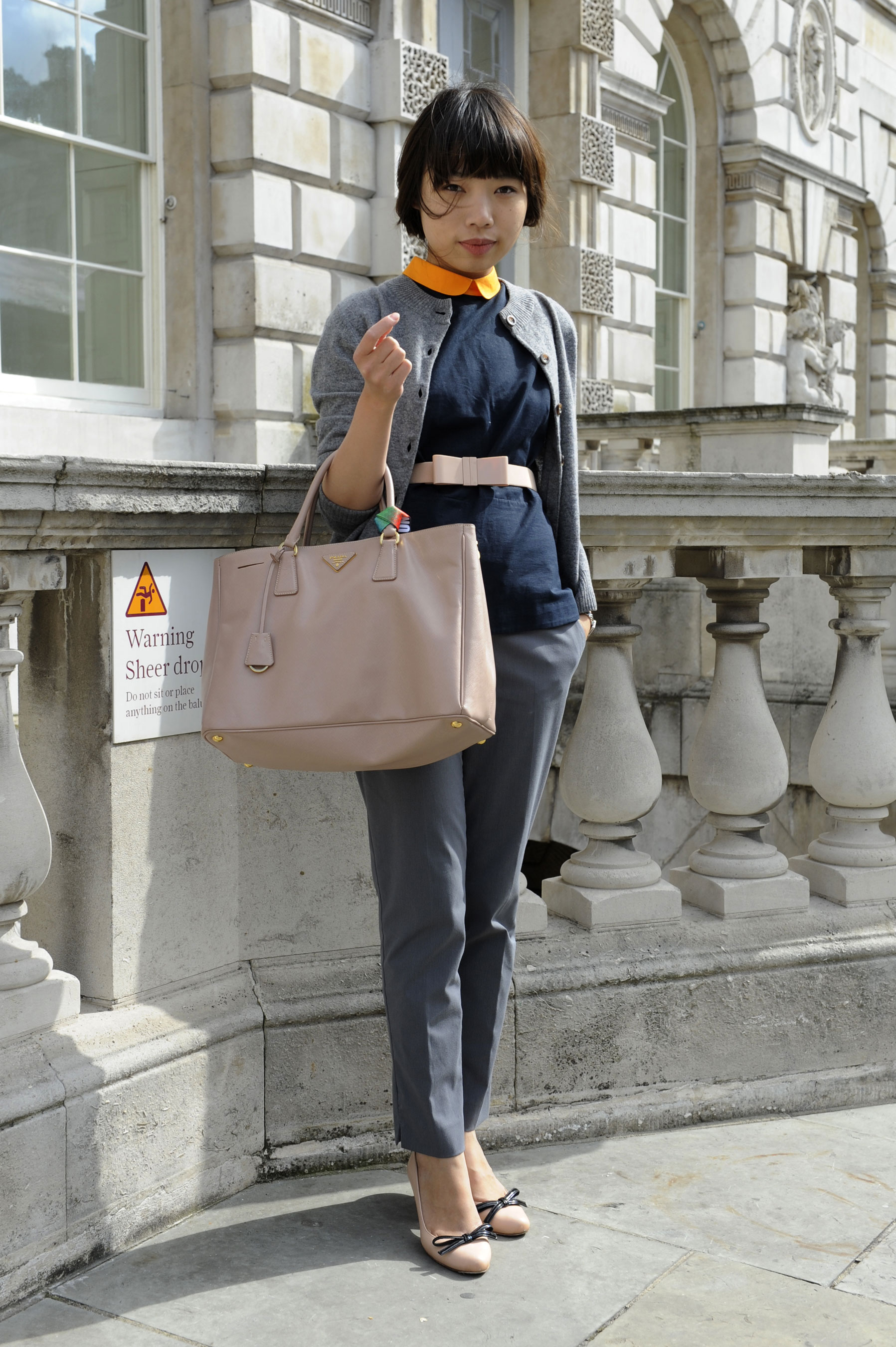 The slick orange collar injects a quirkier vibe to this styler's prim and proper getup.