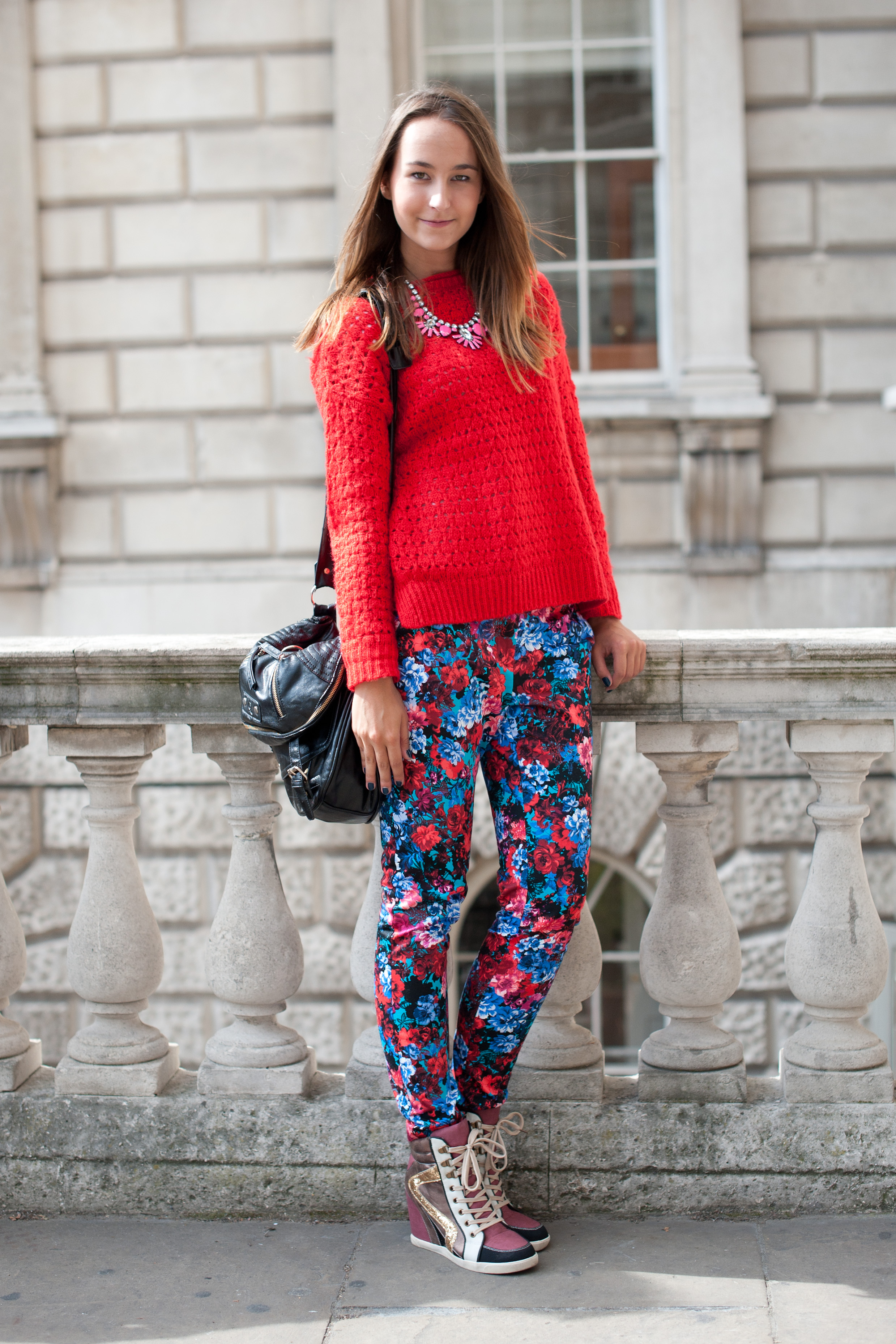 Wearing head-to-toe New Look (a British high street retailer), we're obsessed with her youthful mix of floral trousers, wedge sneakers, and statement jewelry.