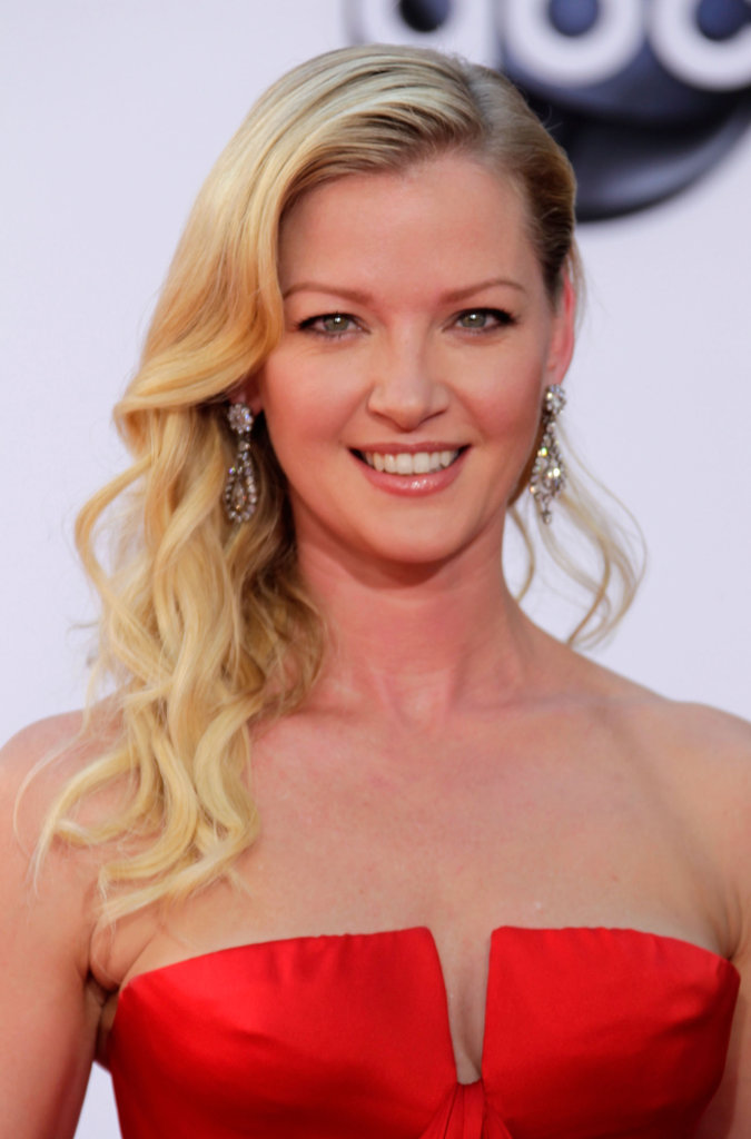 Gretchen Mol wore her hair to one side.