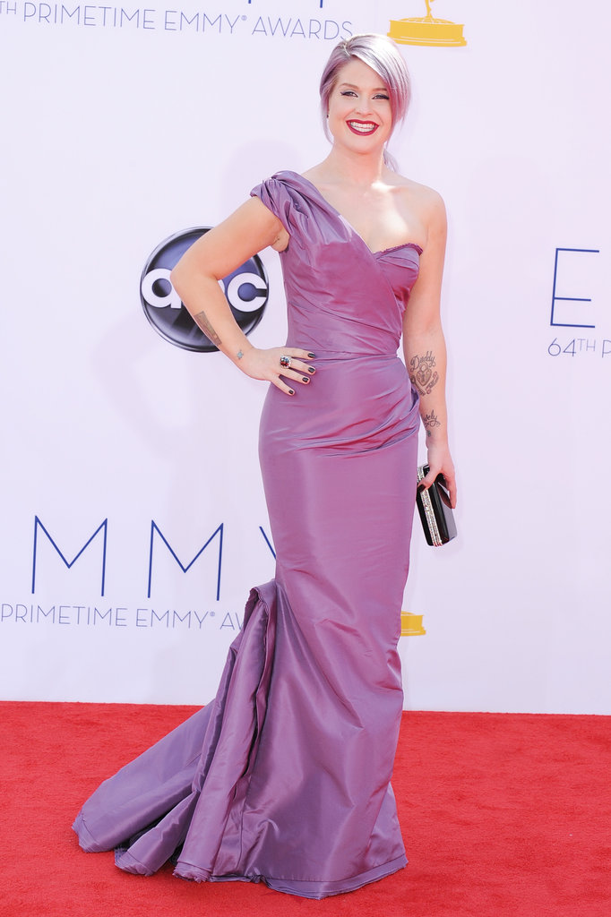 Kelly Osbourne wore a purple gown to match her purple hair at the Emmy Awards.