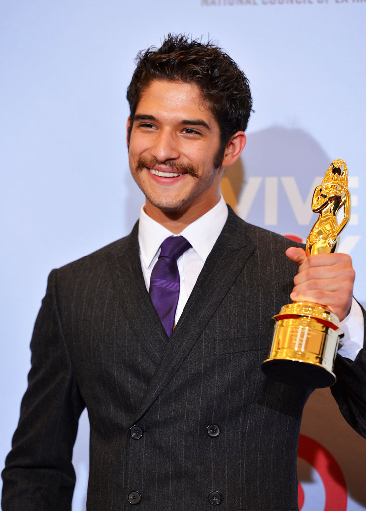 Tyler Posey showed off his award at the ALMA Awards in LA.