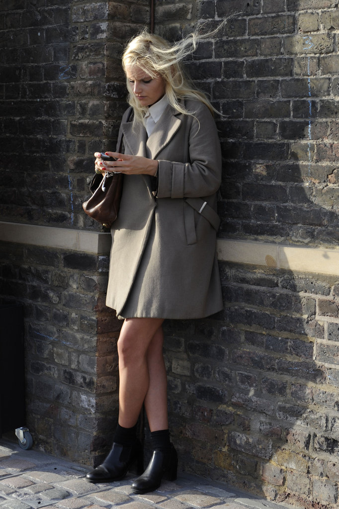 A polished trench-inspired coat can tie an entire outfit together.