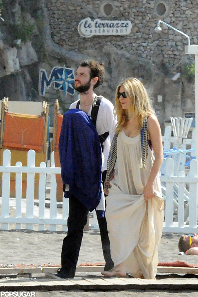 Tom Sturridge carried baby Marlowe in a papoose with Sienna Miller beside him in Positano.