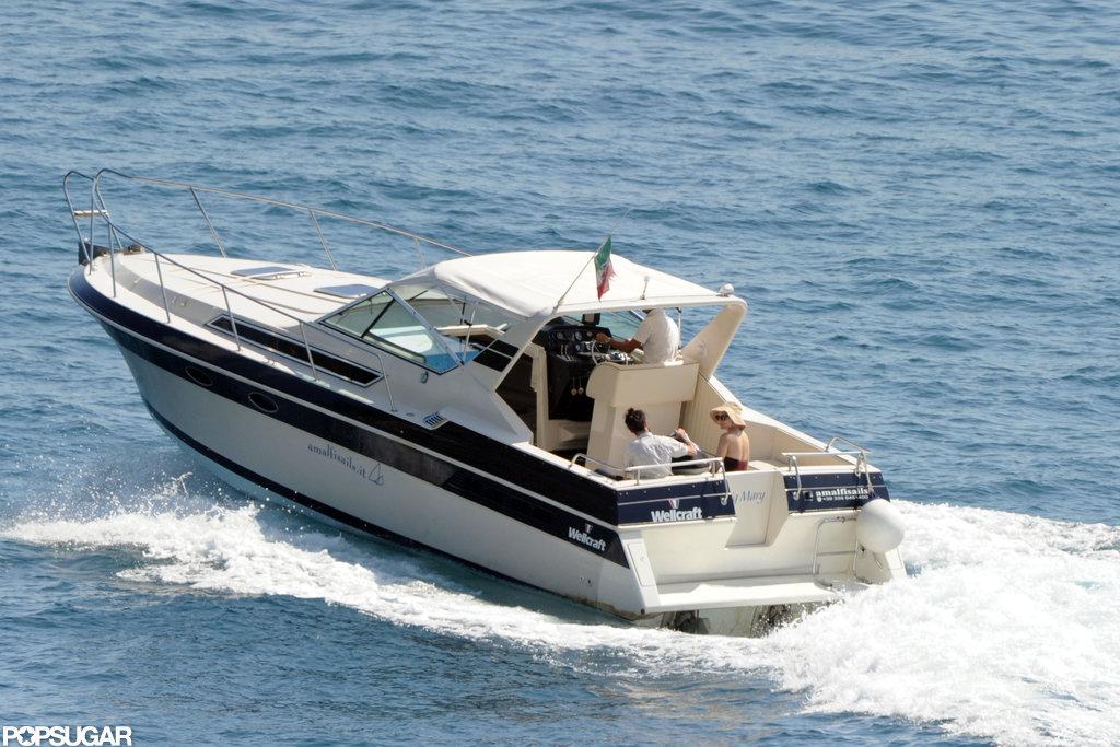 Tom Sturridge, Sienna Miller, and Marlowe Sturridge took a boat ride as a family is Positano.