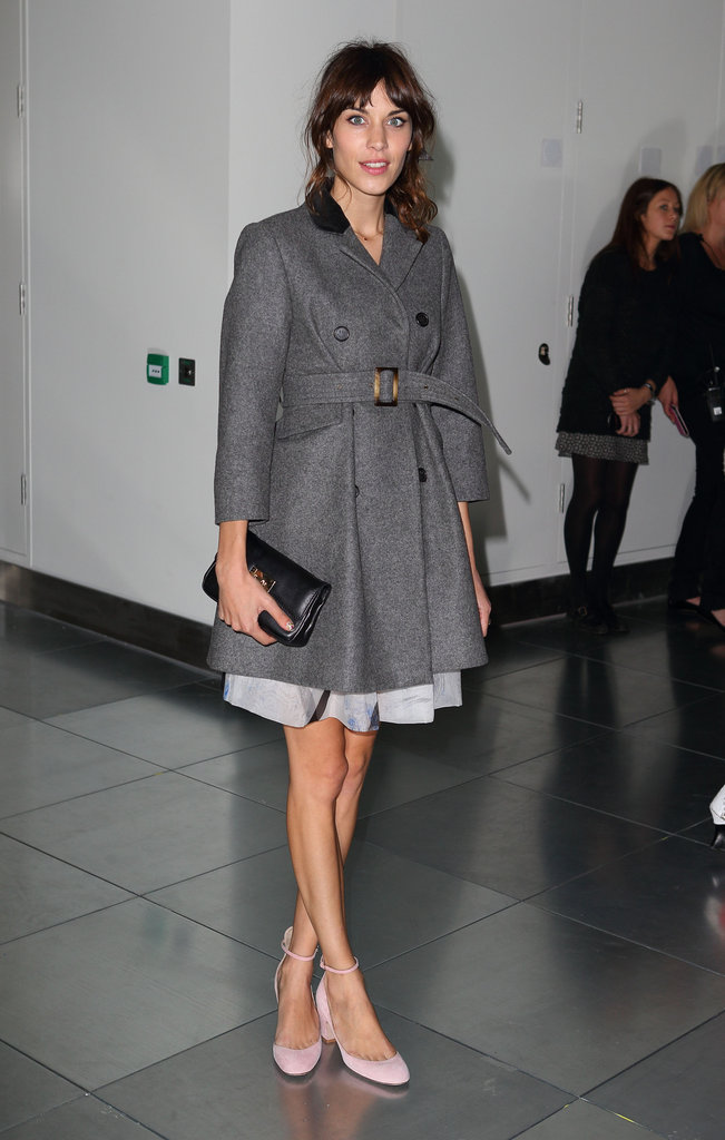 Alexa Chung wore a gray overcoat to the Christopher Kane show.