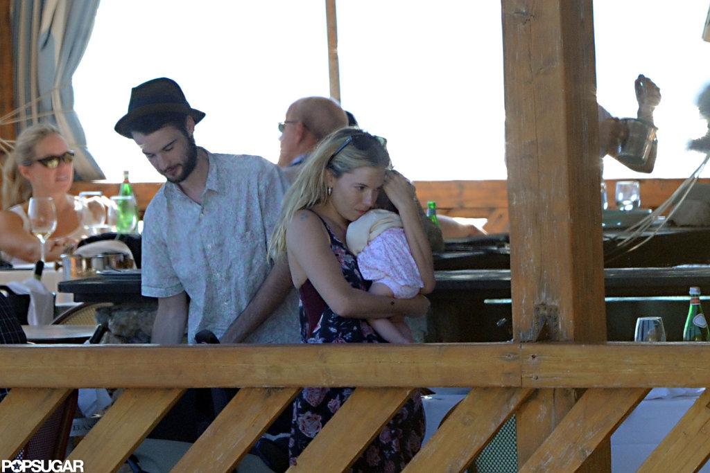 Tom Sturridge watched Sienna Miller hold baby Marlowe.