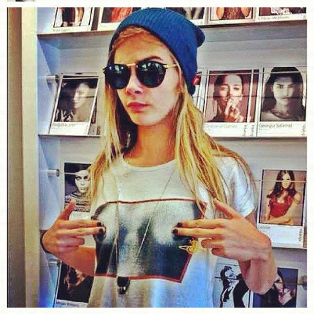 Cara Delevingne made sure to cover up her t-shirt. Source: Instagram user caradelevingne