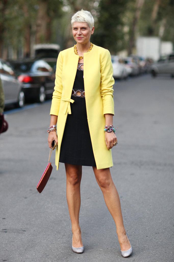 A sweet, lemon-hued coat gave a girlie twist to a cutout dress. Source: Greg Kessler
