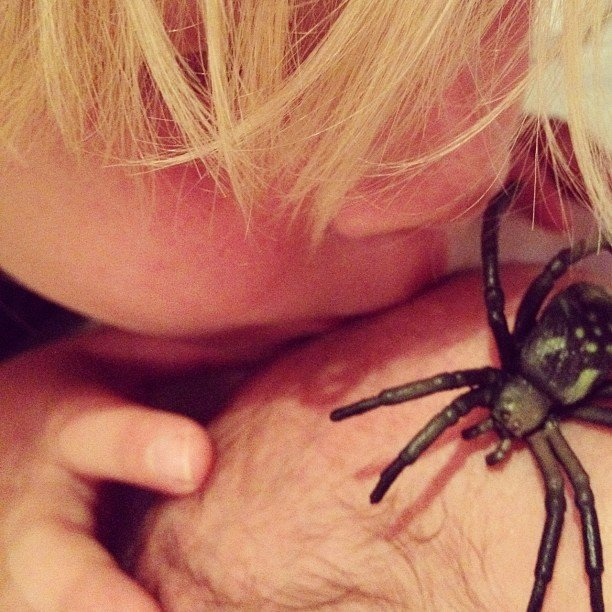 Liam McDermott planted a big kiss (and a toy spider) on his baby brother's head. Source: Instagram user torianddean