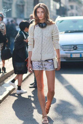 During the transitional style months, try a chunky cable-knit sweater over printed denim shorts. Source: Greg Kessler