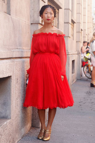 A romantic red off-the-shoulder dress goes perfectly with gold accents.