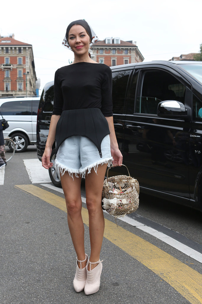 Sure, it's a feminine look on top, but we're loving the frayed denim cutoffs as a tougher addition. Source: IMAXtree