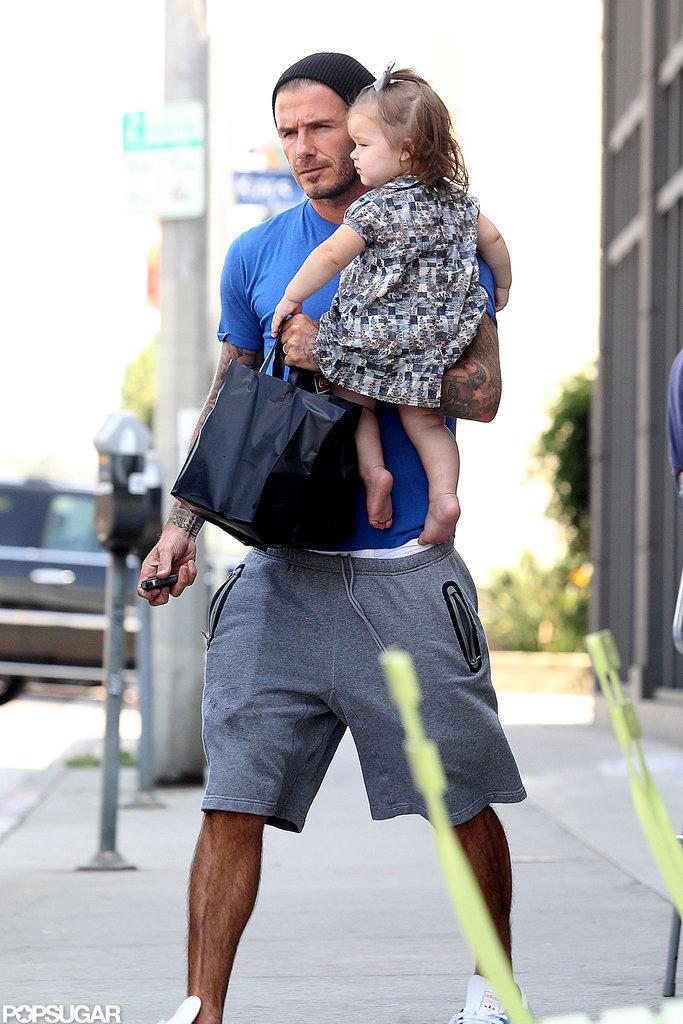 David Beckham carried Harper in LA.