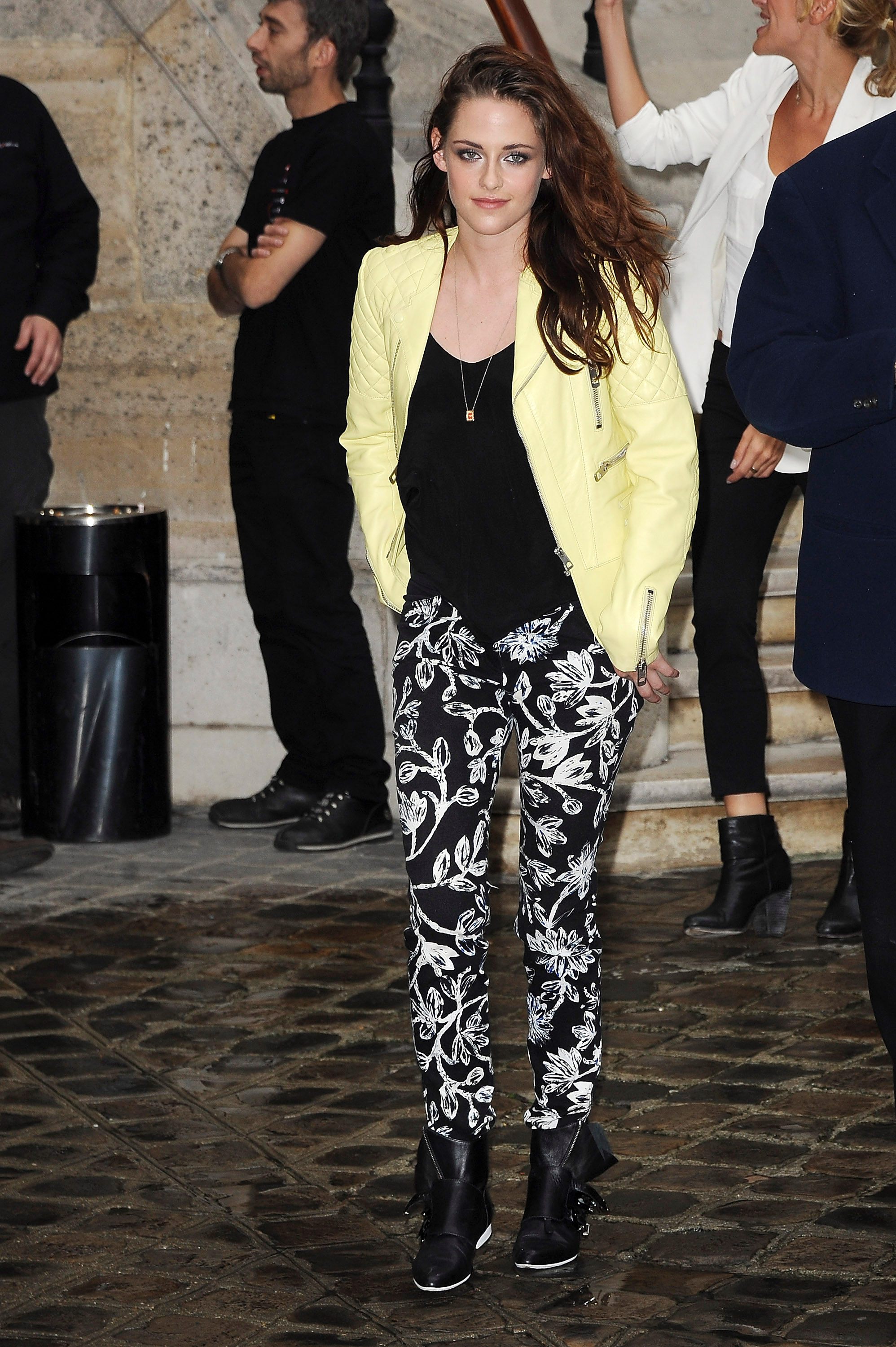 Kristen Stewart turned up the cool on this laid-back ensemble at Balenciaga, pairing a pastel moto jacket with printed trousers. She finished the look with a tough pair of buckled ankle boots.