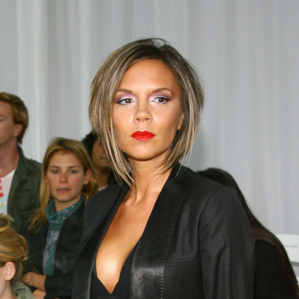 Red lips, coloured shadow and heavily-highlighted hair provided a dramatic look for Victoria in September 2006.