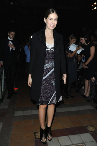 Dasha Zhukova kept it chic in a lacy slipdress and long black blazer at Lanvin.