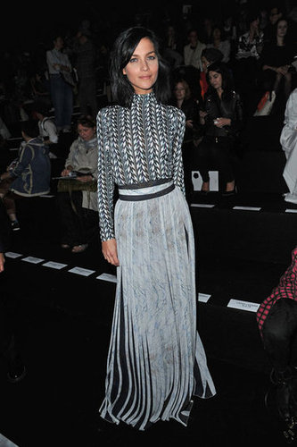 We're loving this pale blue optical illusion — geometric shapes and vertical stripes — courtesy of Leigh Lezark's front-row look at Viktor & Rolf.