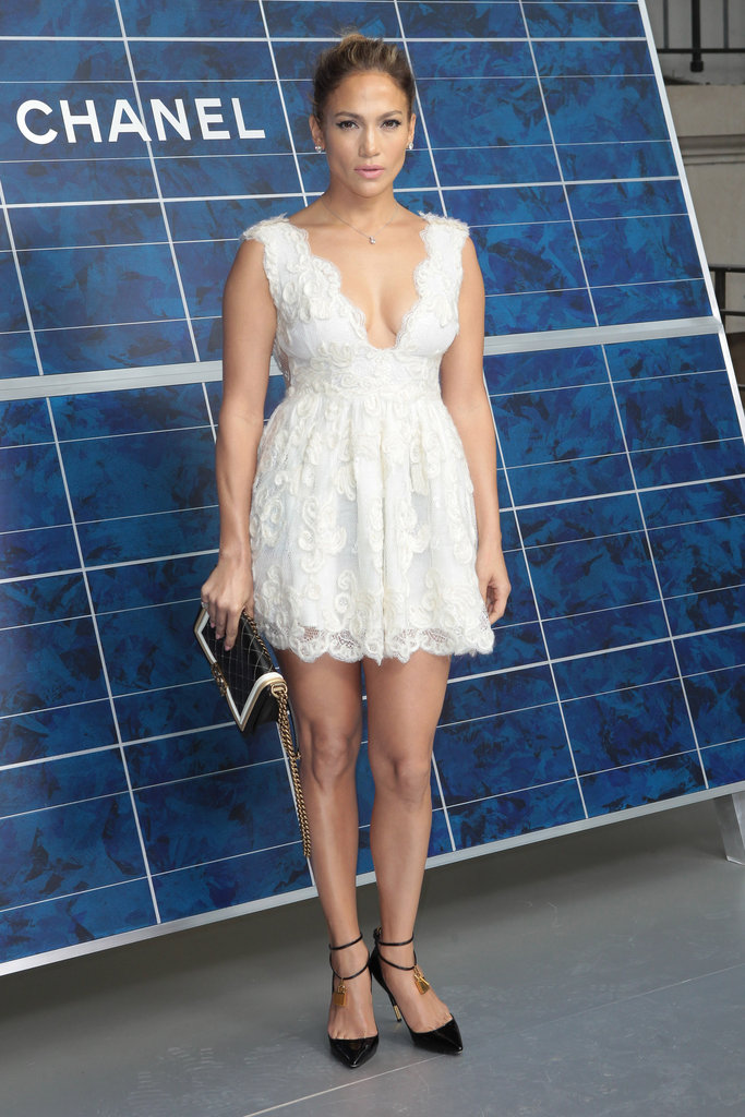 Jennifer Lopez wore a white Chanel dress to attend the show during Paris Fashion Week.
