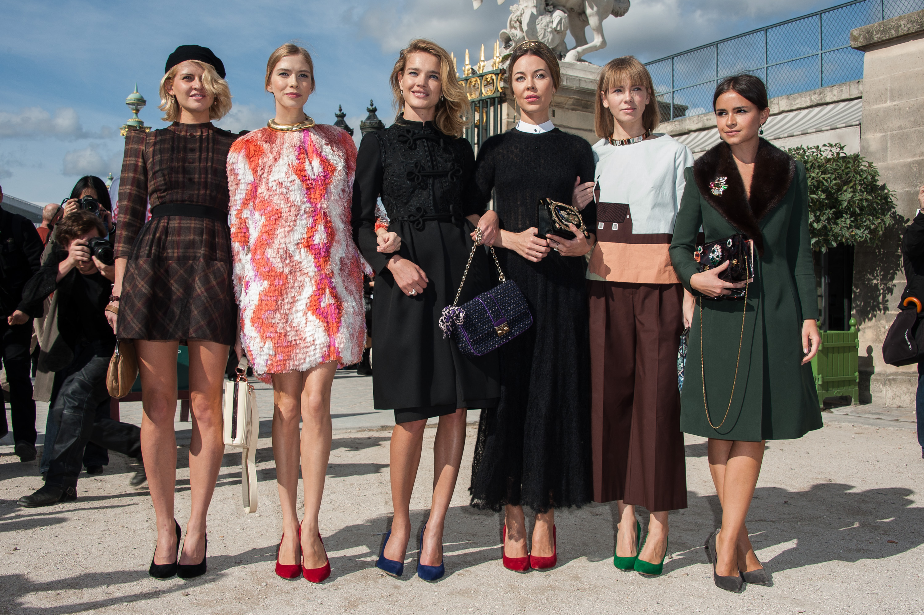 There was just a whole lot of amazing fashion going on outside of the Valentino show — namely from our favorites Natalia Vodianova (middle) and Miroslava Duma (far right).