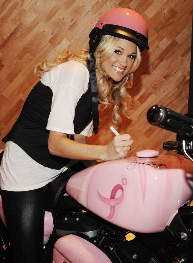 In November 2009, Carrie Underwood wore a pink helmet to pen her autograph on a breast cancer bike in London.
