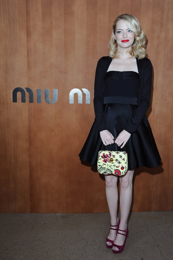 Emma Stone wore a black Miu Miu dress for the designer's show during Paris Fashion Week.