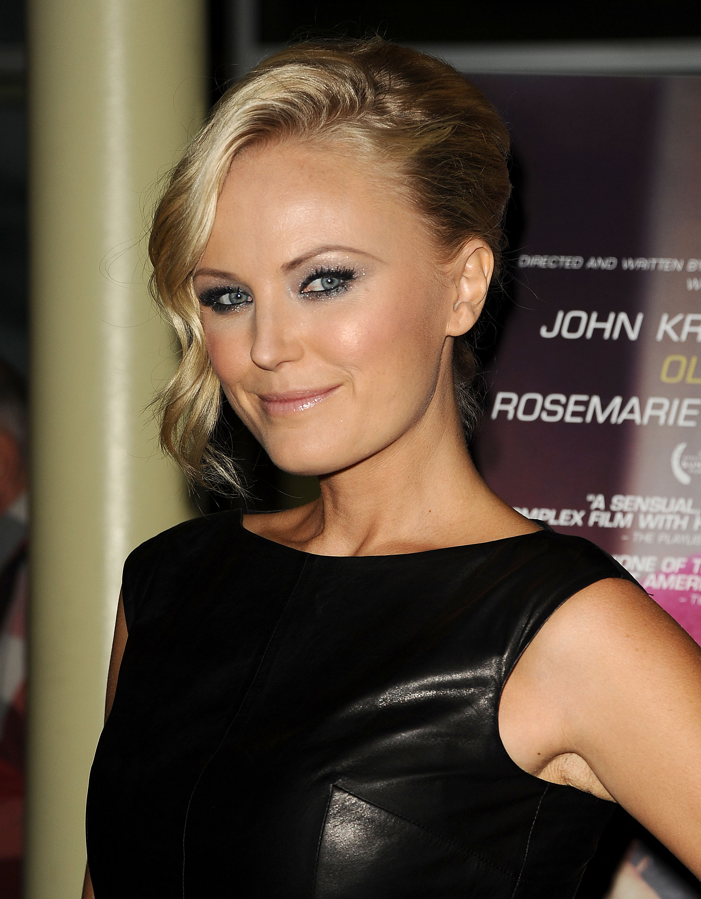 Malin Akerman gave a sexy smirk upon her arrival.