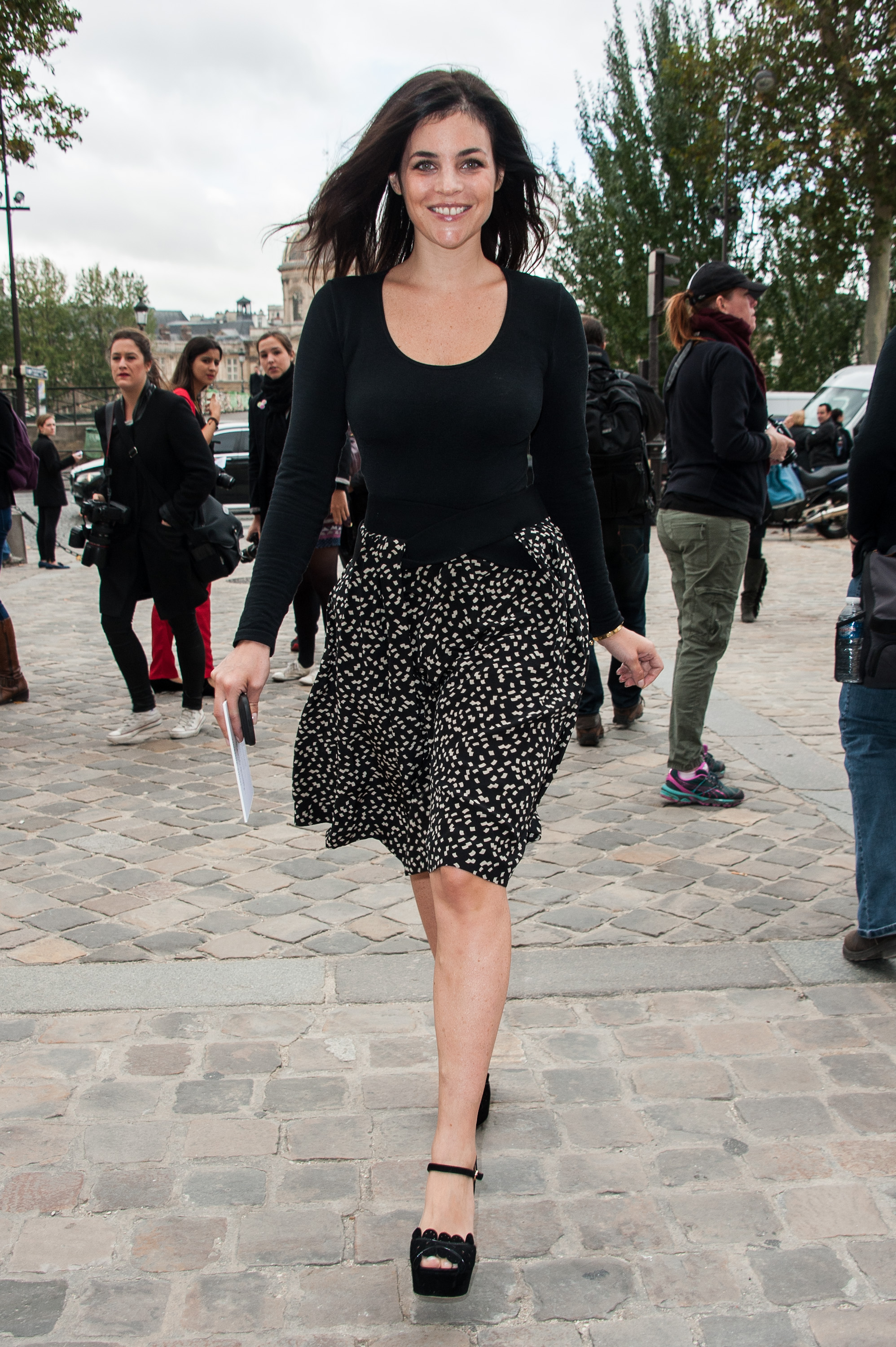 Julia Restoin Roitfeld mixed up her chic black wares with a flirty printed skirt and peep-toe sandals en route to Louis Vuitton.