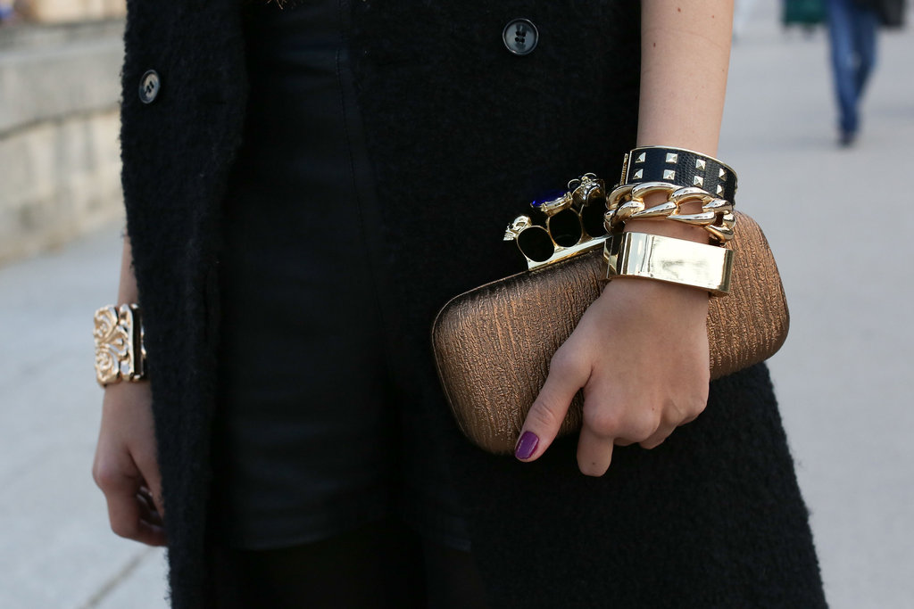 A well-stacked wrist and an Alexander McQueen clutch popped against a classic coat.