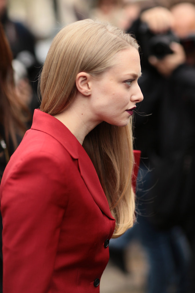 Amanda Seyfried matched her burgundy pout to her fiery red jacket.