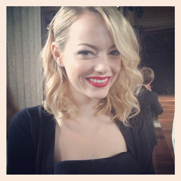 Emma Stone flashed a big smile at the Miu Miu show during Paris Fashion Week. Source: Instagram user hannelim