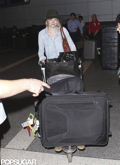 Emma Stone Packs Up Fashion Week Fun and Heads Home