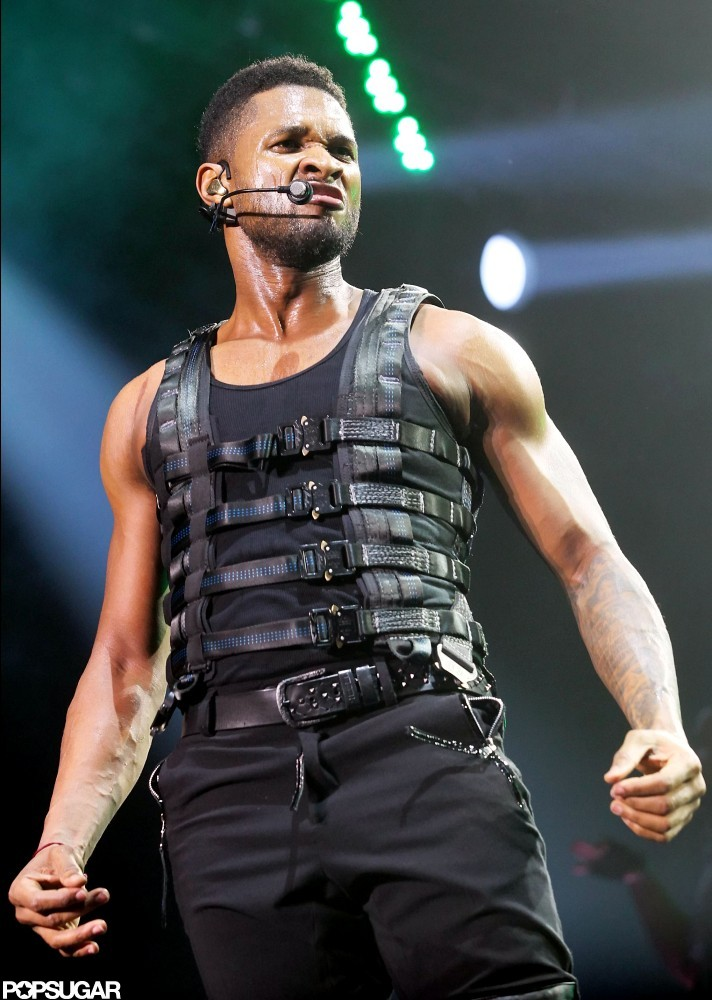 Usher bared his biceps while performing in Belgium in March 2011.