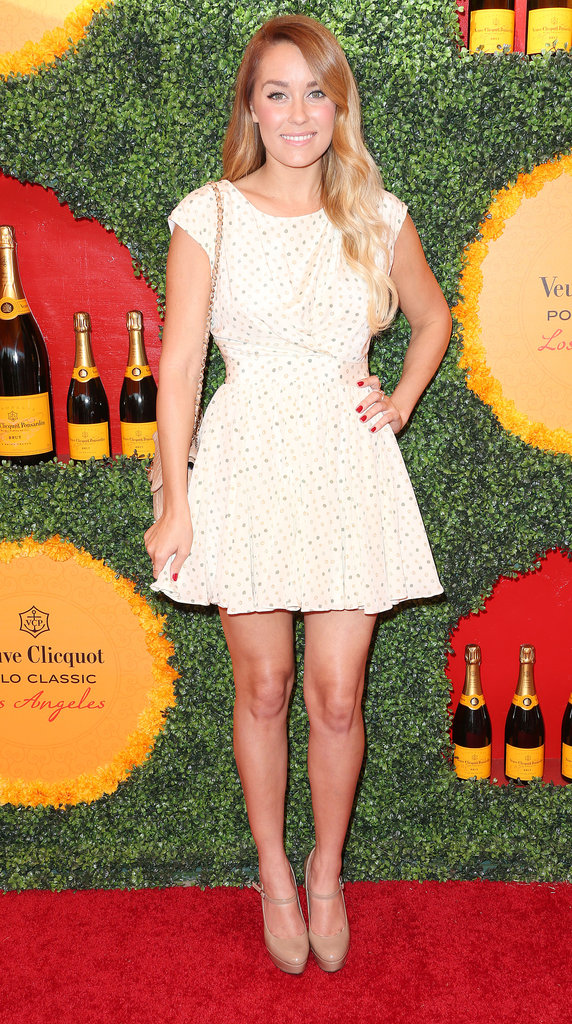 Lauren Conrad proved the chic factor of polka dots with her fit-and-flare Paper Crown dress. We also love that she offset the playful dress with a classic Chanel quilted bag.