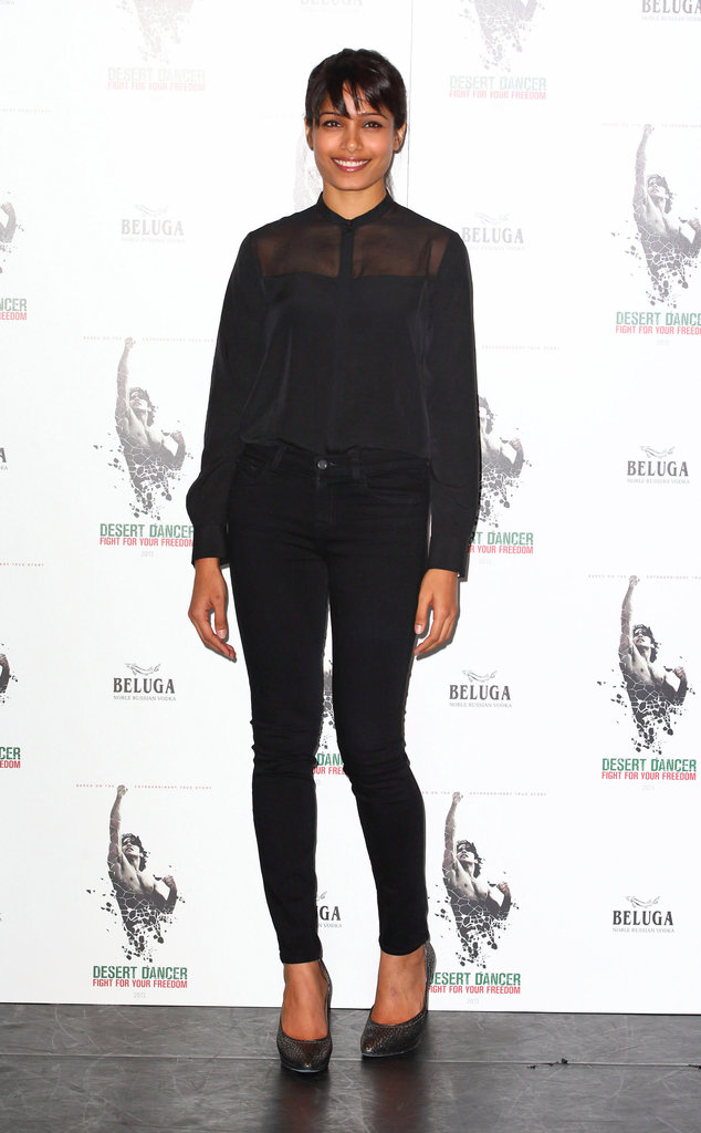 Freida Pinto's all black was anything but basic. The actress styled a sheer AllSaints blouse with staple J Brand skinnies and a pair of sky-high Lanvin heels for a casual albeit sexy look at a London photocall.