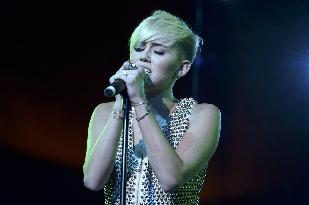 Miley Cyrus wore a studded top to perform in LA.