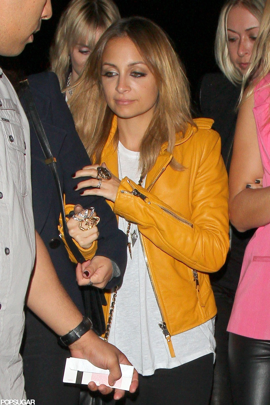 Nicole Richie wore a yellow leather jacket.
