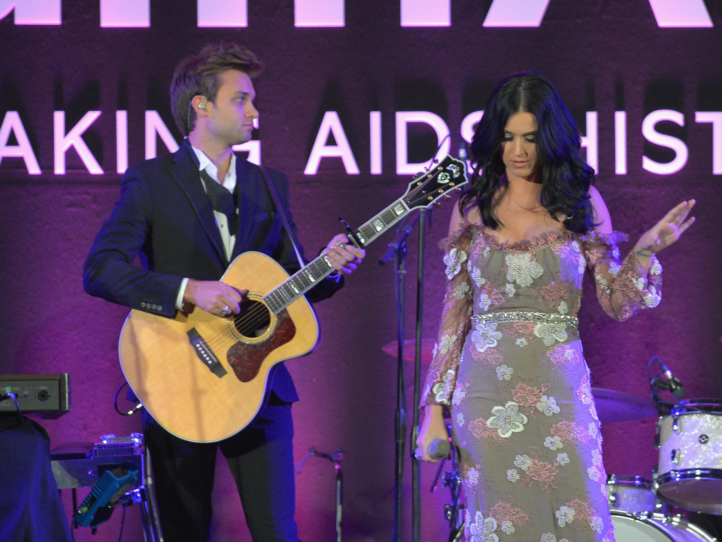 Katy Perry chose a floral dress to perform at the amfAR Inspiration Gala in LA.