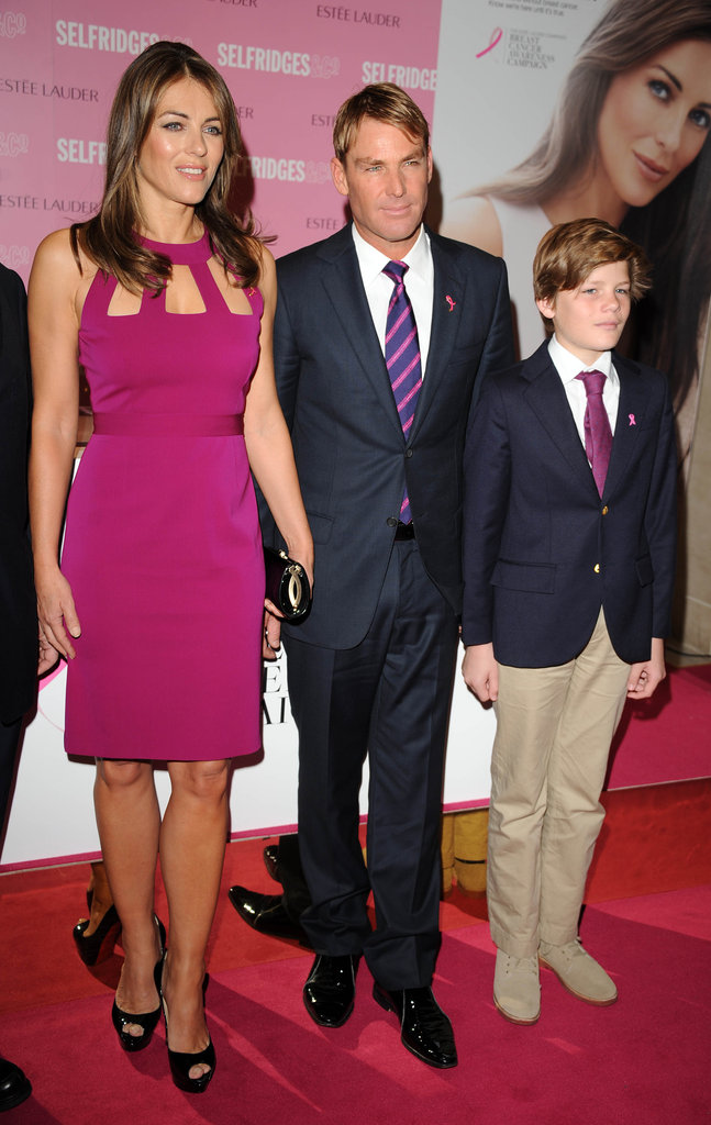 Liz Hurley, Shane Warne and Liz's son Damien made a cute-looking family at an Estee Lauder photocall in London on October 8.