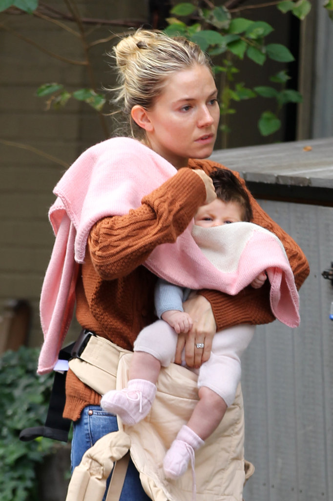 Sienna Miller toted three-month-old daughter Marlowe around as she walked through NYC on October 10.