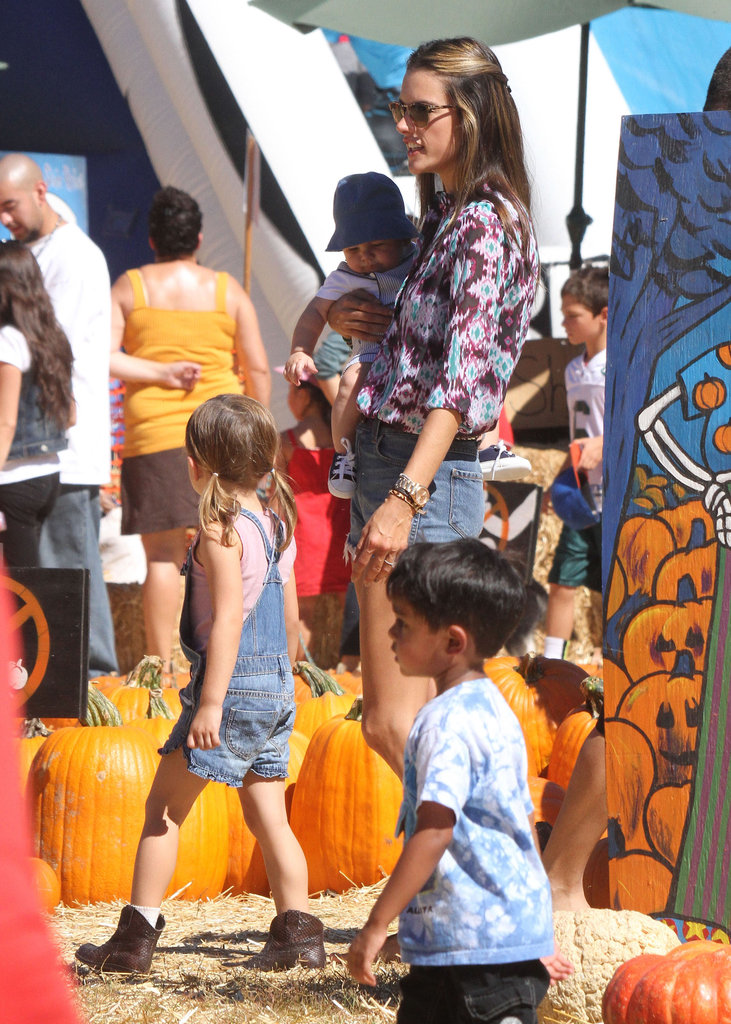 Alessandra Ambrosio showed off her legs in short cutoff shorts to accompany Anja and Noah through the pumpkin patch in LA.