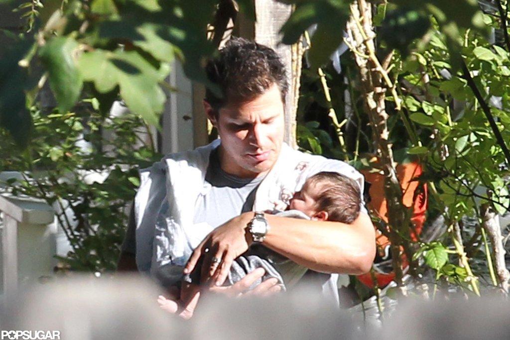 Nick Lachey carried baby Camden Lachey.