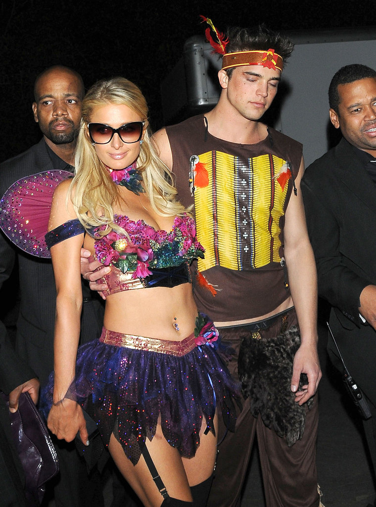 Paris Hilton and her boyfriend showed off another set of costumes at Playboy's party in LA Saturday.