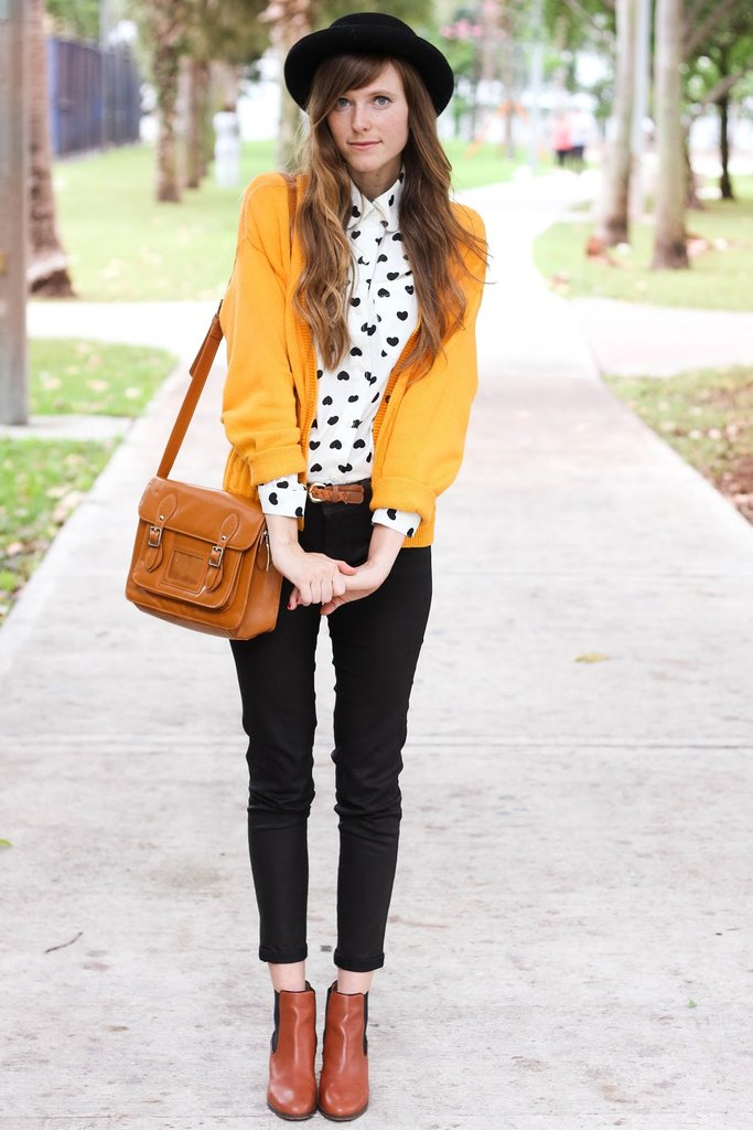 Sometimes it just takes a pop of color to perk up your style — we love the way her mustard hues play against black and brown leather. Source: Lookbook.nu