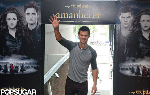 Taylor Lautner waved to fans in Brazil.