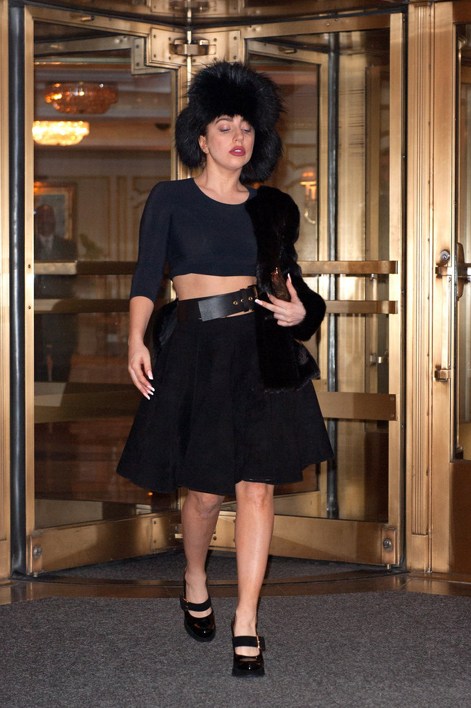 Lady Gaga joined the celebrity crowd at Versace's private dinner prior to the store opening, and bared her midriff in a crop top and midi skirt combo, complete with a fur hat.