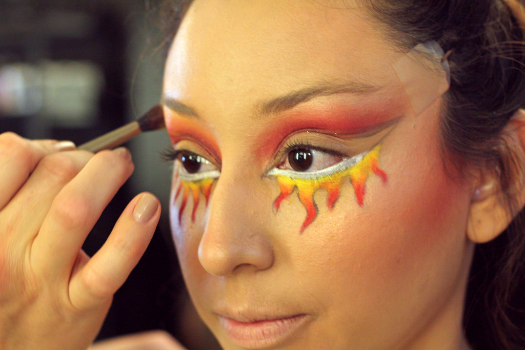 More Chromaline —here, in the Basic Red and Genuine Orange shades —intensified the fire. A little more Devil blush and pigment, applied above the crease of the eyelid, did the same.