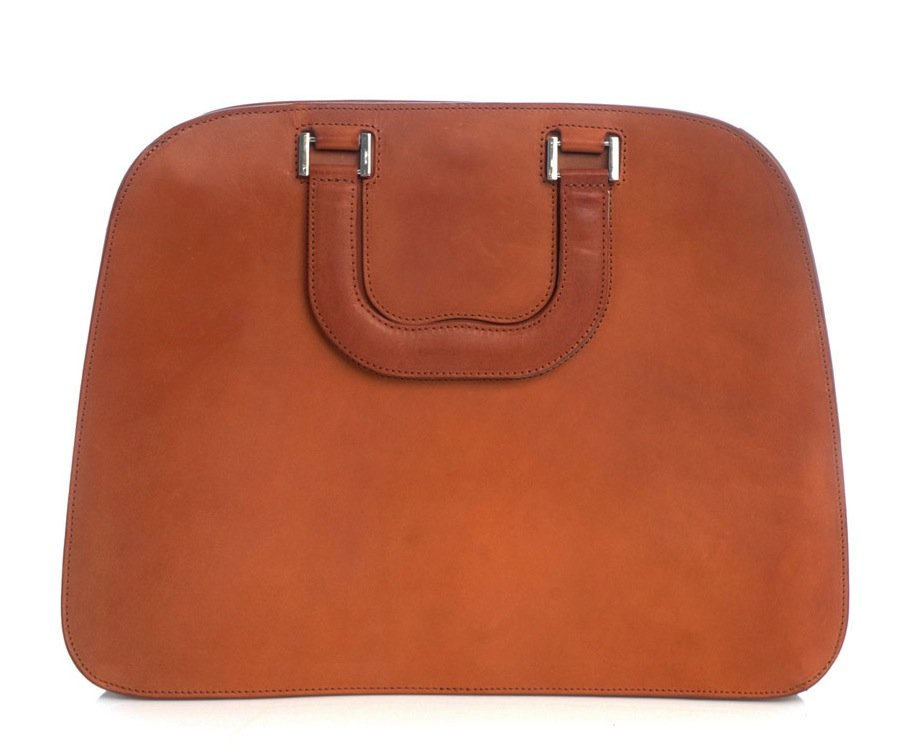 How cool is this burnt-orange hue? Leave it to Maison Martin Margiela ($1,577) to create a minimalist's doctor bag in the most appropriate Fall shade.