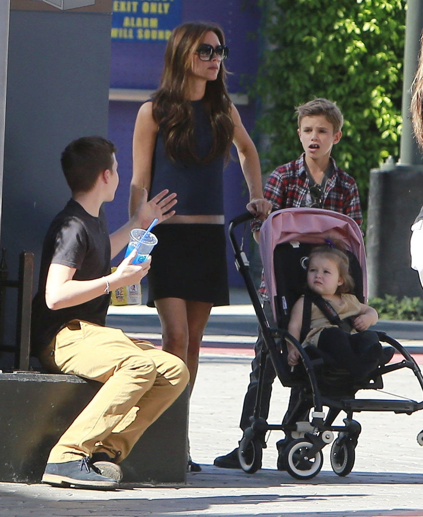 Victoria Beckham wore flats for a day of shopping with Harper and the boys.